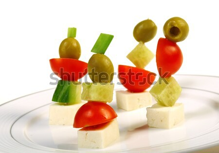 Canape platter with cheese, cucumber,tomato,olives Stock photo © fanfo
