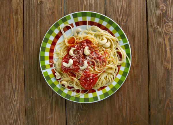 Spaghetti italiana pasta salsa di pomodoro anacardi dadi Foto d'archivio © fanfo