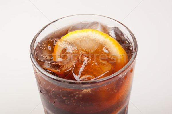 Ice cube droped in cola glass Stock photo © fanfo