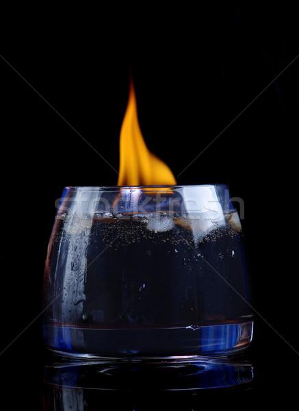 Cola cognac feu verre noir or Photo stock © fanfo