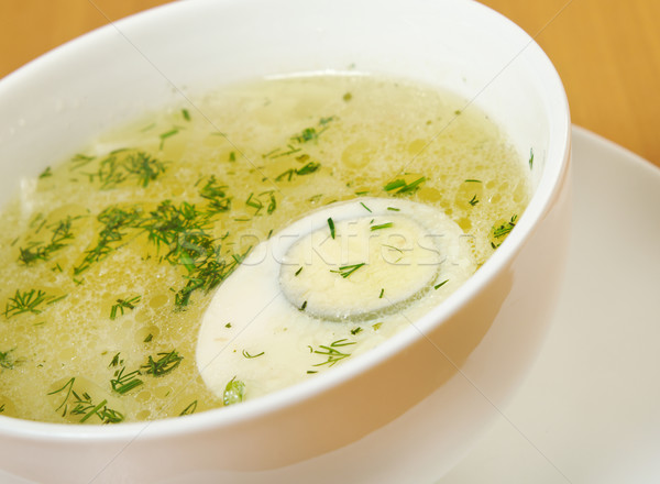 Chicken broth with dill and egg. Stock photo © fanfo
