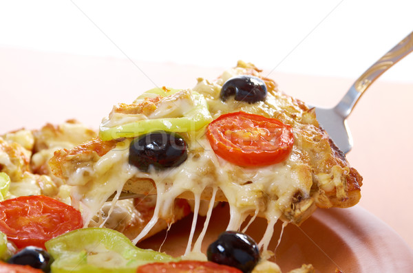 taking slice of pizza,melted cheese dripping Stock photo © fanfo