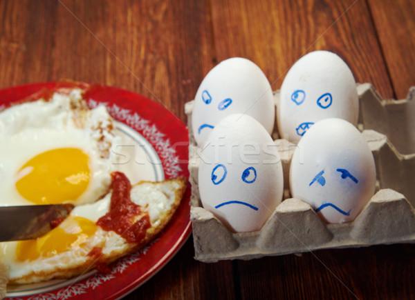 Huevo miedo cara huevo frito primer plano alimentos Foto stock © fanfo