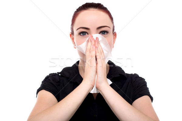 Businesswoman blowing her nose Stock photo © fantasticrabbit