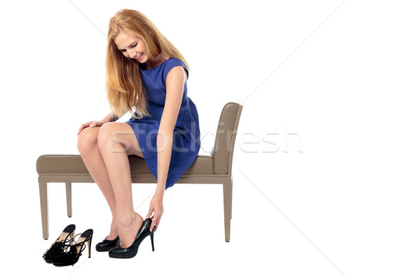 Elegant woman changing her shoes Stock photo © fantasticrabbit