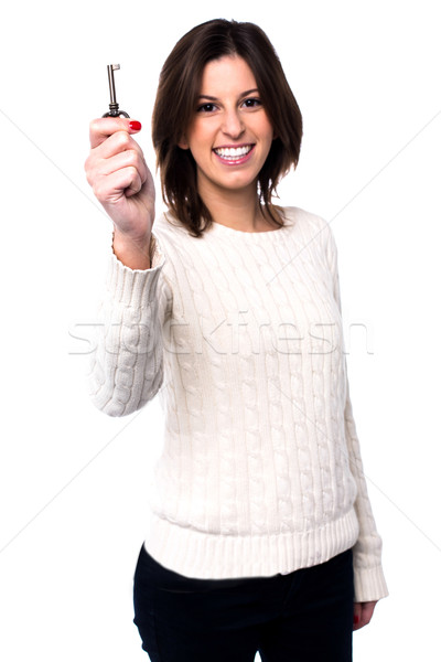 Woman holding up a house key Stock photo © fantasticrabbit