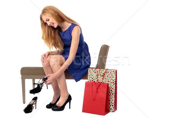 улыбающаяся женщина новых пару обувь сиденье магазине Сток-фото © fantasticrabbit