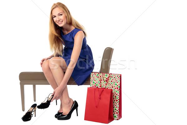 Happy female shopper choosing shoes Stock photo © fantasticrabbit