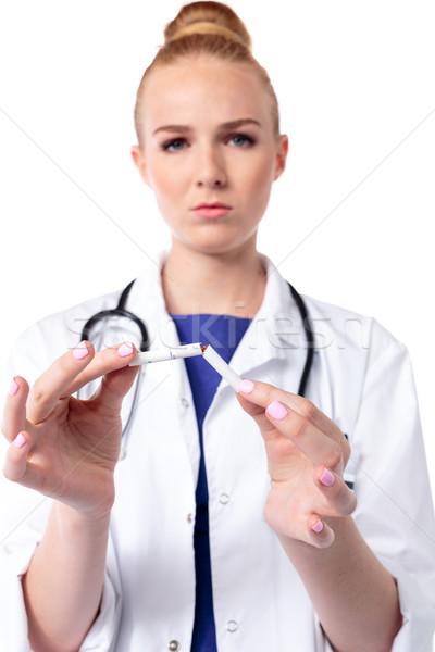Médico cigarro dois sério feminino aviso Foto stock © fantasticrabbit