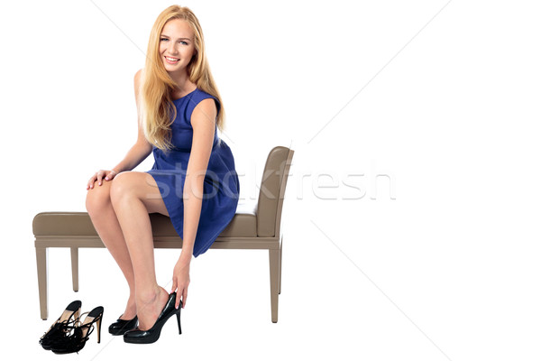 Fashionable woman changing her shoes Stock photo © fantasticrabbit