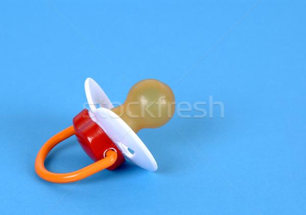 Emzik mavi kırmızı kauçuk uyku Stok fotoğraf © farres