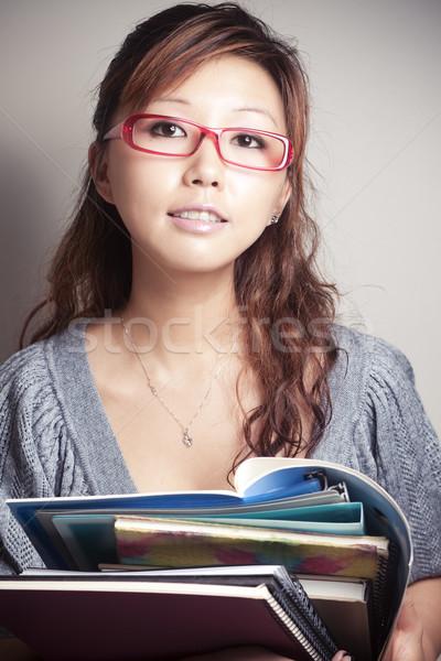 Vissza az iskolába ázsiai lány tart tankönyv visel Stock fotó © fatalsweets