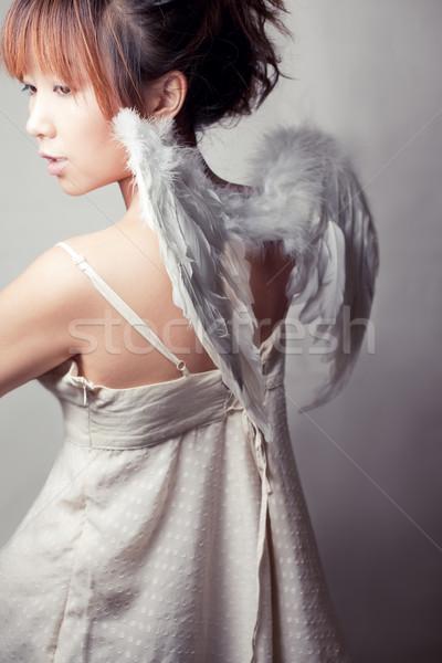 Légy messze lány visel fehér felső Stock fotó © fatalsweets