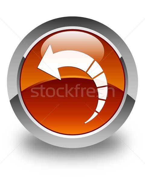 Back arrow icon glossy brown round button Stock photo © faysalfarhan