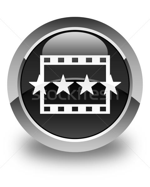 Movie reviews icon glossy black round button Stock photo © faysalfarhan