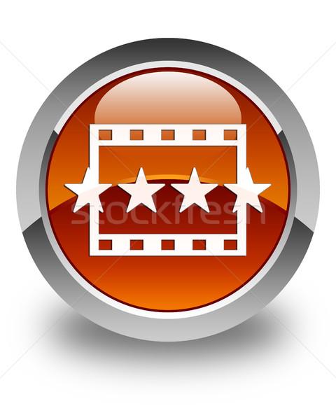 Movie reviews icon glossy brown round button Stock photo © faysalfarhan