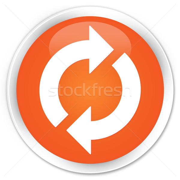 Aggiornare icona arancione pulsante segno bianco Foto d'archivio © faysalfarhan