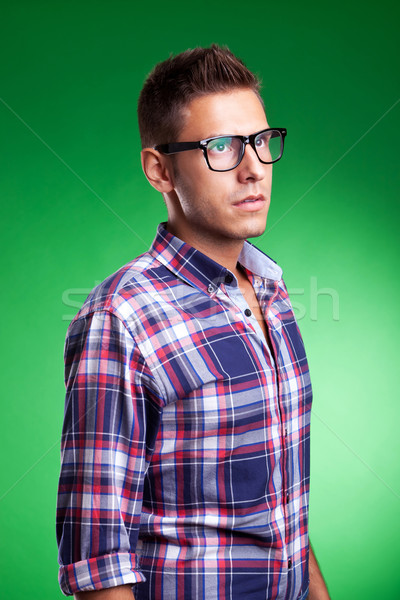 Young man model posin in a squared shirt Stock photo © feedough