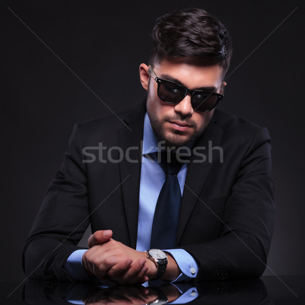 young business man with hands together checks watch Stock photo © feedough