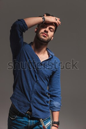 fashion man passing his hand through  his hair near girlfriend Stock photo © feedough