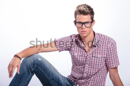 attractive man posing seated with legs spread open  Stock photo © feedough