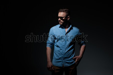 interesting young man posing with hand behind his neck Stock photo © feedough