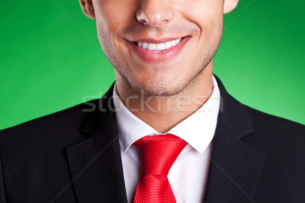 a young red tie business man smiling Stock photo © feedough