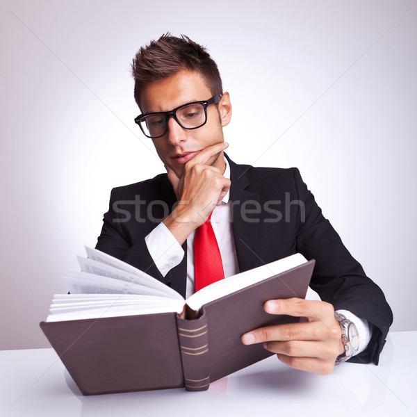 intrigued business man reading a book  Stock photo © feedough