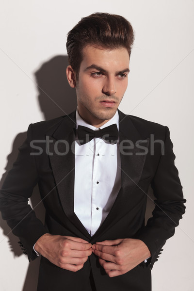 Handsome young fashion man looking away  Stock photo © feedough