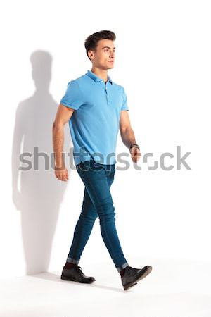 confident young casual man in polo shirt and jeans walking Stock photo © feedough
