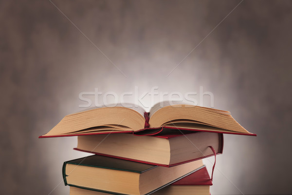 open book on top of pile of books Stock photo © feedough