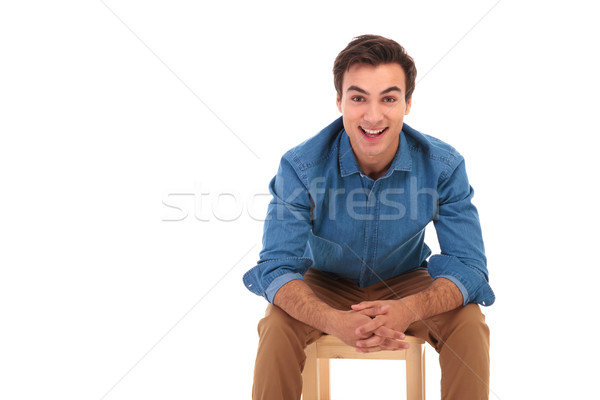 smiling casual man resting elbows on knees while sitting Stock photo © feedough