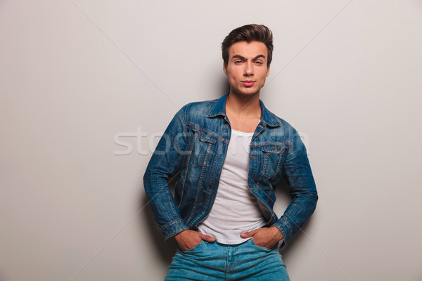 serious man in jeans jacket standing with hands in pockets Stock photo © feedough