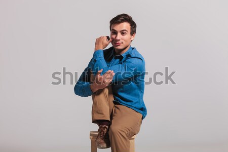 sexy smart casual man buttoning his blue suit jacket Stock photo © feedough