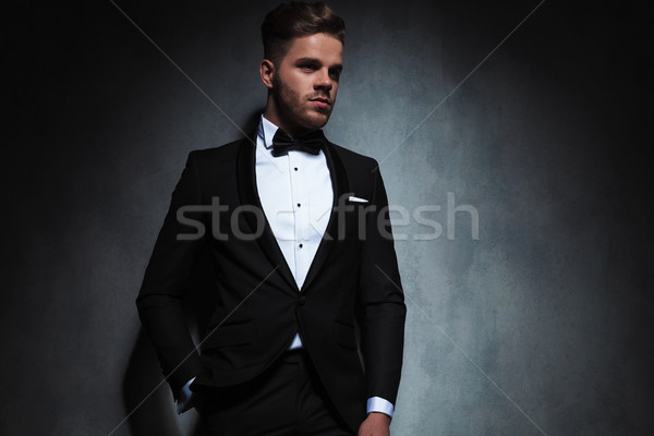 portrait of relaxed elegant man in tuxedo looking to side  Stock photo © feedough