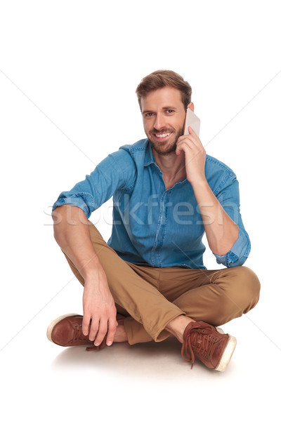 smiling seated casual man talks on the phone Stock photo © feedough