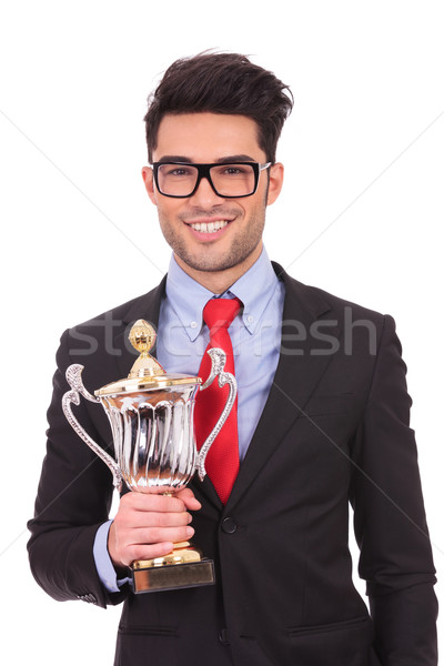 business man holds trophy Stock photo © feedough