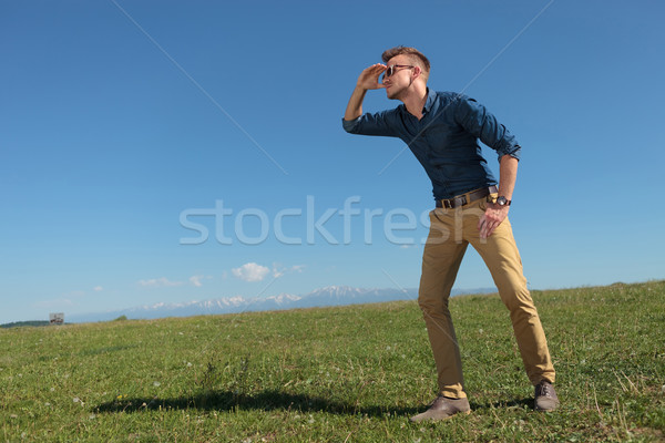 casual man looks far away Stock photo © feedough