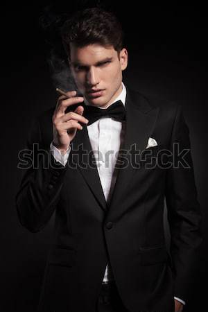 elegant fashion man making the quiet sign  Stock photo © feedough