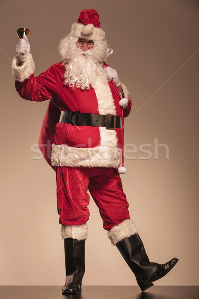 Santa Claus ringing a bell and holding a big bag Stock photo © feedough
