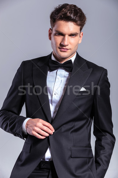 Young business man unbuttoning his tuxedo Stock photo © feedough