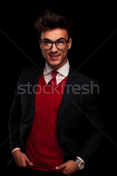 Stílusos modell fekete öltöny kezek portré visel Stock fotó © feedough