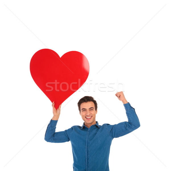 young man holding big red heart is celebrating love Stock photo © feedough