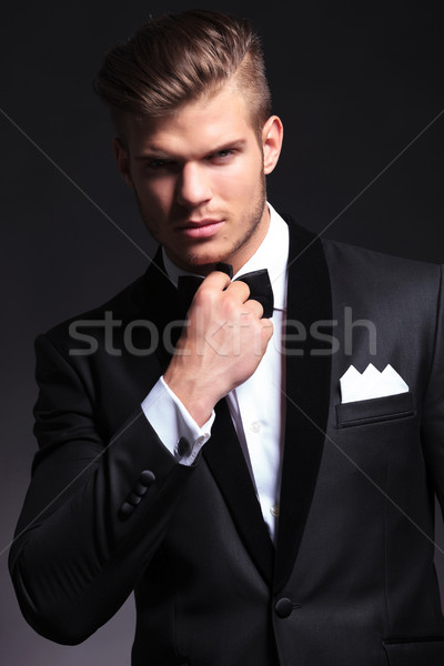 business man adjusting his bow tie Stock photo © feedough