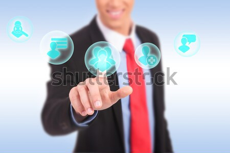 business man pressing a MUSIC button  Stock photo © feedough