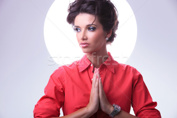 young woman with aura prays and looks away Stock photo © feedough