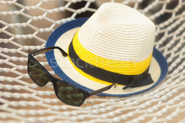 соломенной шляпе Солнцезащитные очки гамак фотография лет Сток-фото © feedough