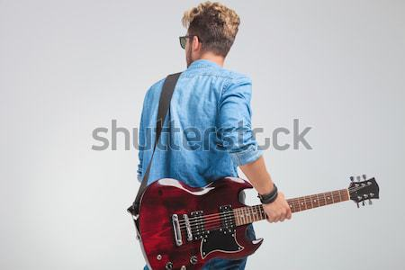 relaxed guitarist with hand behind his neck Stock photo © feedough