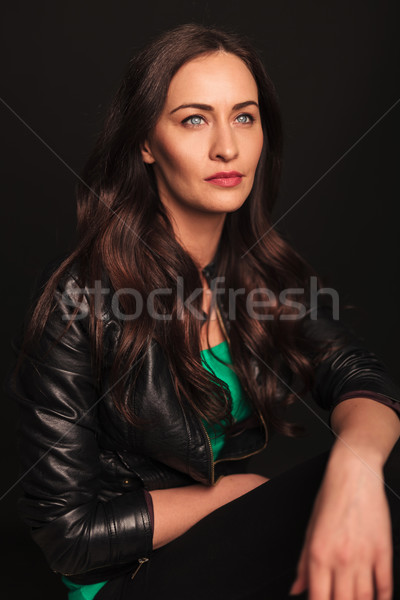 seated woman with hands on knees looking away Stock photo © feedough