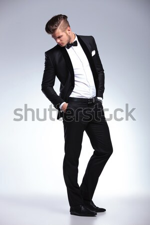 seductive businessman with leg on wooden box points to side Stock photo © feedough
